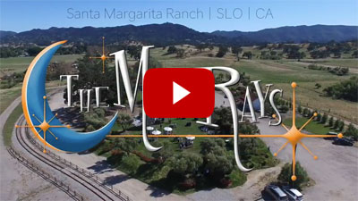 the moonrays logo overlayed on top of a wedding scene set at a ranch in santa margarita california